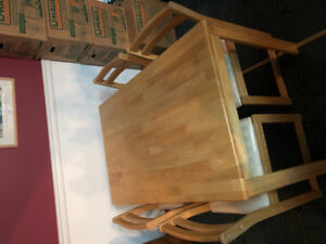 Small light wood kitchen table with 4 chairs