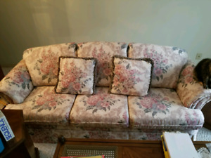 Traditional floral living room couch and armchair