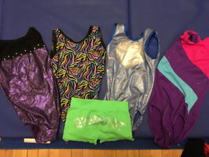 Four gymnastics suits. Fit 10-12.