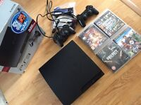 PS3 playstation 3 with box and games and controllers