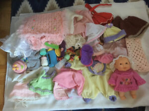 Lot of  doll clothes and small doll
