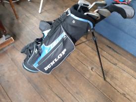 Child's set of Dunlop sixty five golf clubs.