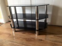 Black glass and chrome TV unit