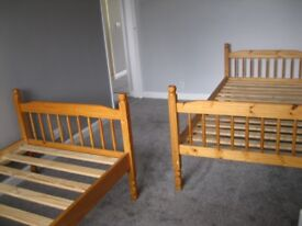 BUNK BEDS OR TWO SINGLE PINE BEDS AND MATTRASSES