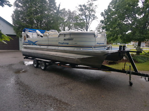 20 foot pontoon boat with trailer.
