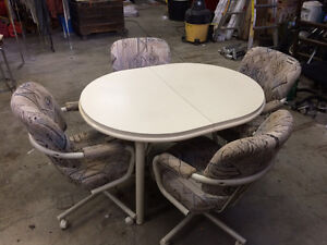 White Table with Four Great Chairs