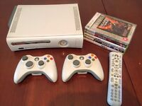 Mint condition boxed Xbox 360, 2 controllers, remote & 5 games