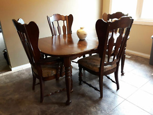 Antique dining table and chairs.
