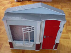 Maison avec poupée