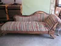 an antique couch / lounge chair