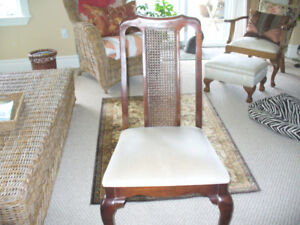 Two caned back Walnut side chairs, Like New.