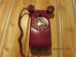 red rotary dial wall phone
