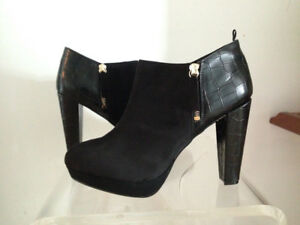 Black suede and faux leather high heel boots