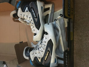 Goalie skates with toe clips attached