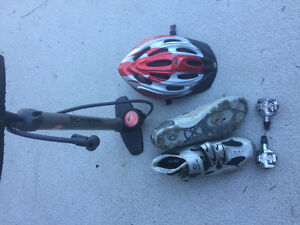 Mountain bike shoes, clips peddles, helmet and pump