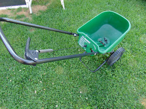 1 scotts weed and feed spreader working good left by .$30  514-