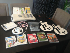 Nintendo Wii fit board, games, guitars and accessories lot