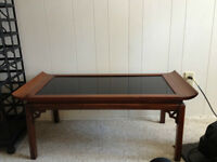 Antique coffee table with black glass top inlaid