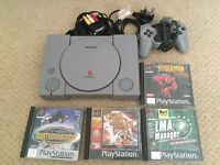 PlayStation 1 with 4 games - good condition