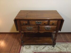 Beautiful old serving table, with sides. Two drawers on casters