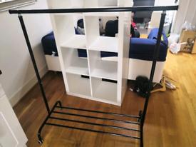 Extendable black clothes rail with shoe shelf