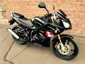 125 geared learner bike, as new condition, warranty, 365 miles, excellent condition.