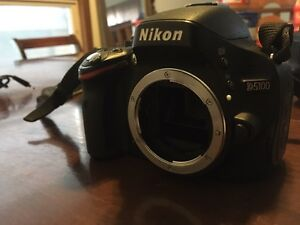 Nikon D5100 with cleaning kit and tripod and memory card