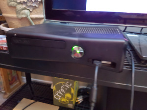 x box 360 and 2 contollers plus 12* games
