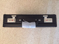 Black expandable brief case new. By iT Luggage