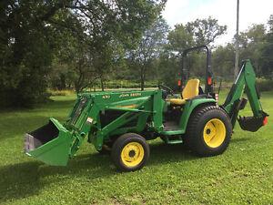 John Deere compact tractor with backhoe