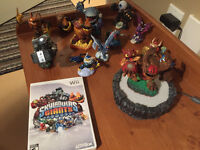 Skylanders Wii game with dock and 14 figurines.