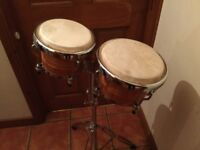 Two bongo drums and stand
