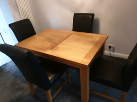 Solid oak extendable dining table plus chairs