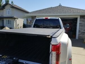 TONNEAU COVER .  BAK REVOLVER X2. FITS FORD F250 350 AND 450