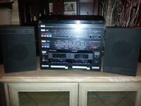 AMSTRAD , RECORD VINYL PLAYER -TWO CASSETTE -RADIO, TWO SPEAKERS
