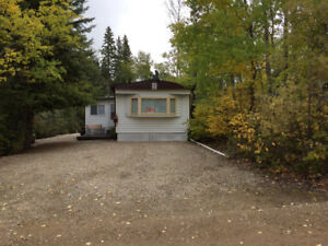 REDUCED PRICE on Mobile Home on large leased lot at Emma Lake