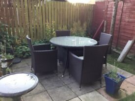 Rattan garden table with four chairs