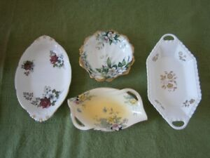 FOUR PRETTY CHINA CANDY DISHES