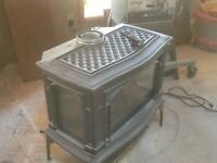 Free standing gas fireplace.   Reduced