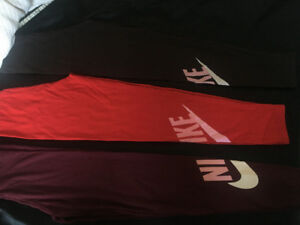 red, maroon, and brown Nike tights. Size small