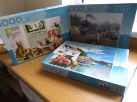 Assorted 1000 piece jigsaw puzzles. Complete.