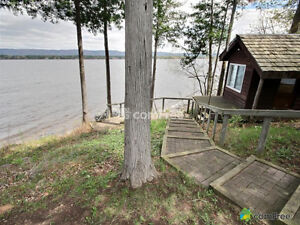$30,000 PRICE REDUCTION - Waterfront Home in Dunrobin Shores
