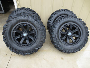 Polaris rims with Pro Comp Xtreme trax tires,Great Condition