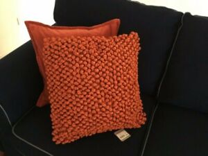 Two orange throw/ scatter cushions