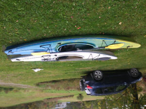 2 Gannet Necky Kayaks 11ft long with paddles.and vechile racks.