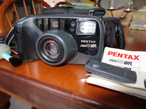 Pentax 35mm water resistant camera –zoom + remote $20