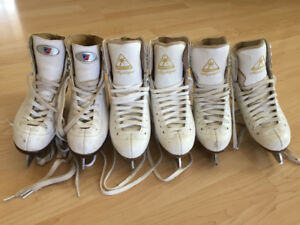 3pairs of girls figure skates