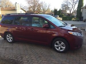 2014 Toyota Sienna. Extra winter rims and tires