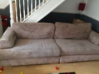 4 Seater Beige Fabric Sofa in good condition.