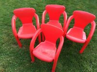 Four Red Plastic Children's Chairs
